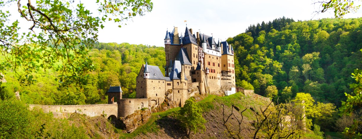Side view of the Eltz Castle from the forest Muenstermaifield
