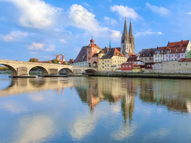 View from Danube on Regensburg Cathedral and Stone Bridge