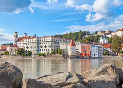 Buildings and Schaibling Tower on the side of Inn River near its confluence with Danube
