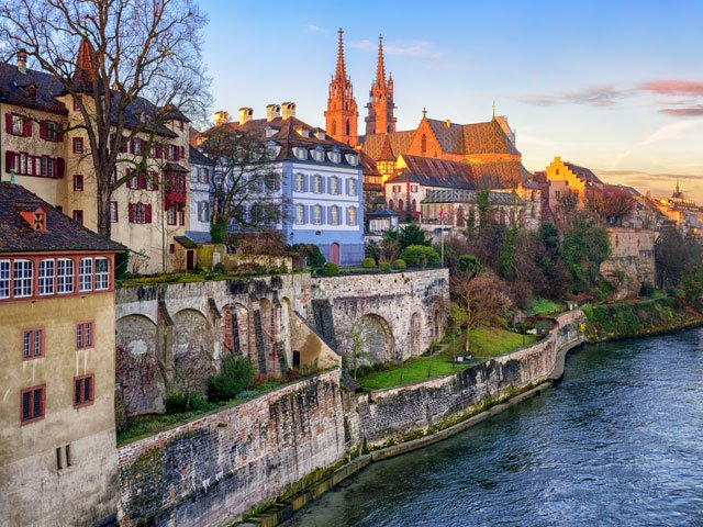 Old town of Basel with red stone Munster cathedral on the Rhine River