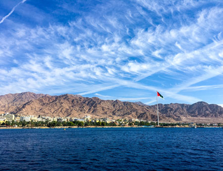 Flag of Jordan on the river in Aqaba