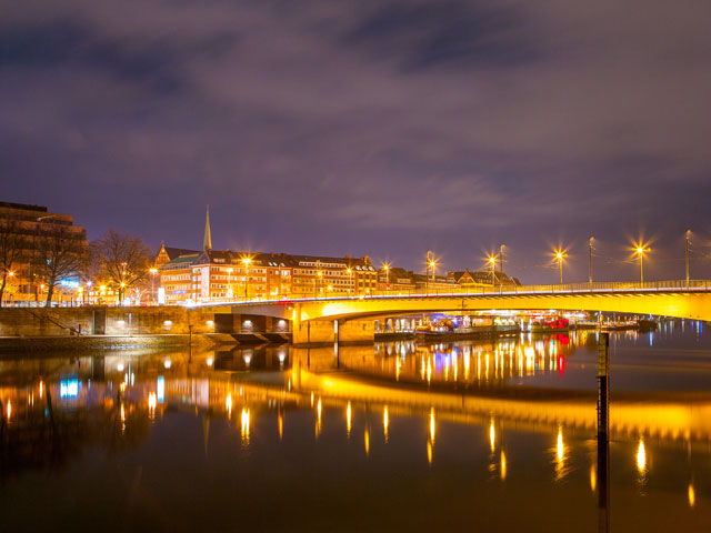 Bremen at night with river bridge, Germany