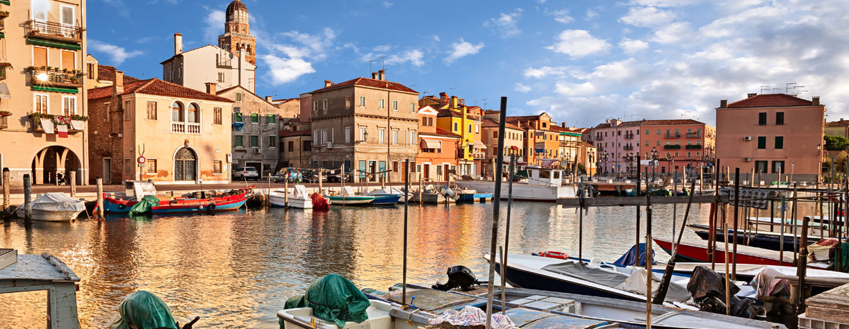 River boats and waterfront buildings in Chiogga, Italy
