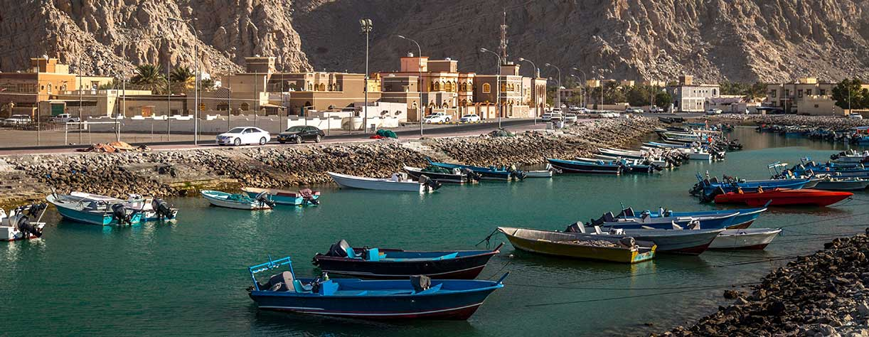 Boats anchored in the river in Khasab, Oman