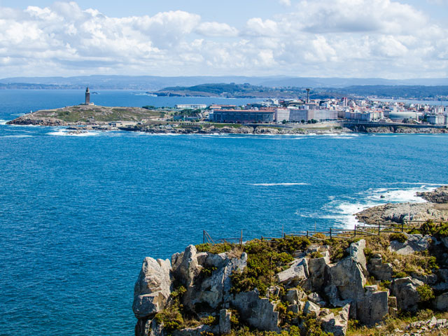 Atlantic ocean shore. Tower of Hercules from the Monte de San Pedro Park, La Coruna