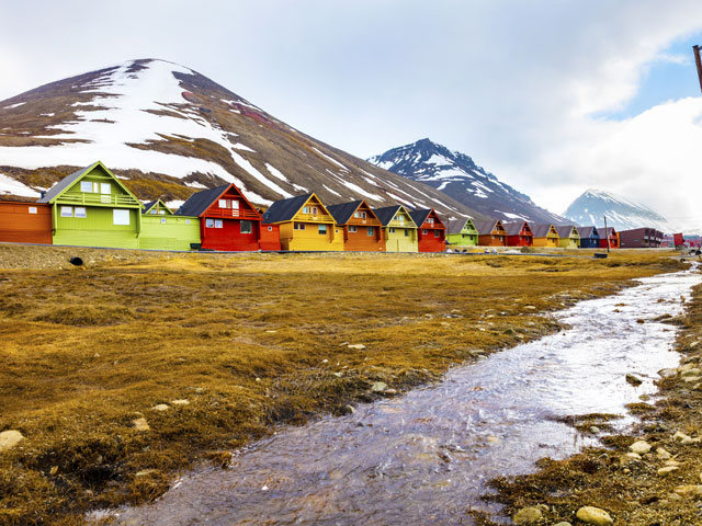 Colourful houses and mountains in background, Svalbard