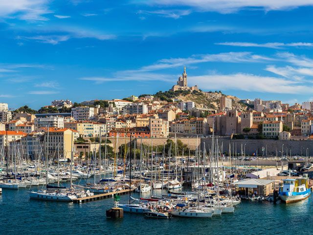 Aerial panoramic view on basilica of Notre Dame de la Garde and old port in Marseille