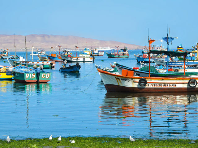 Boats in the sea with Black Watch in the distance, Peru