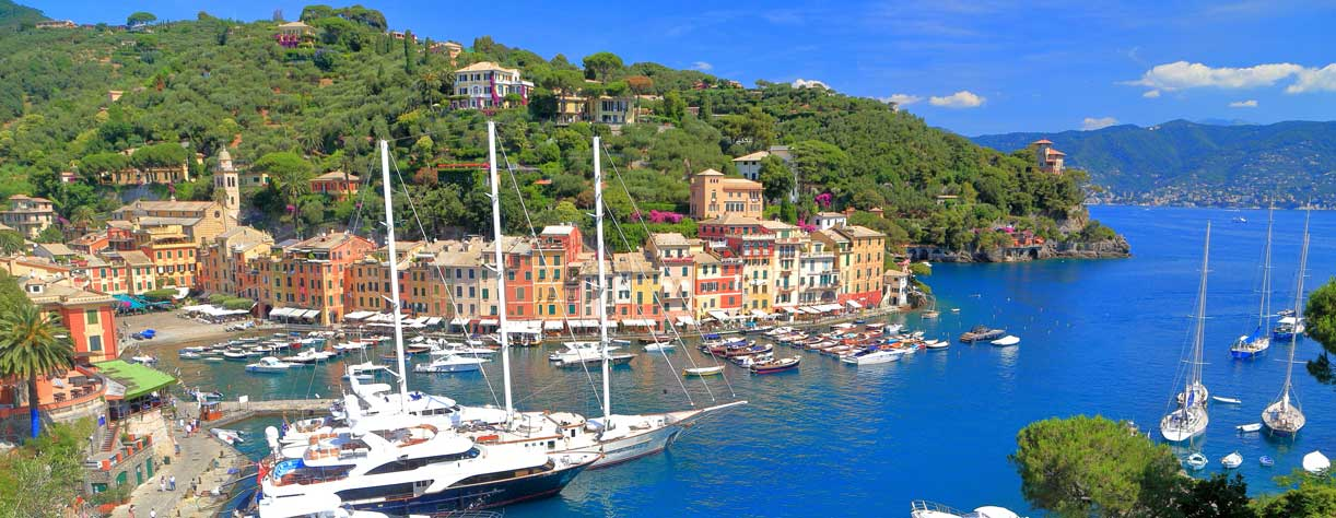 Luxury yachts inside the harbour of Portofino, Italy