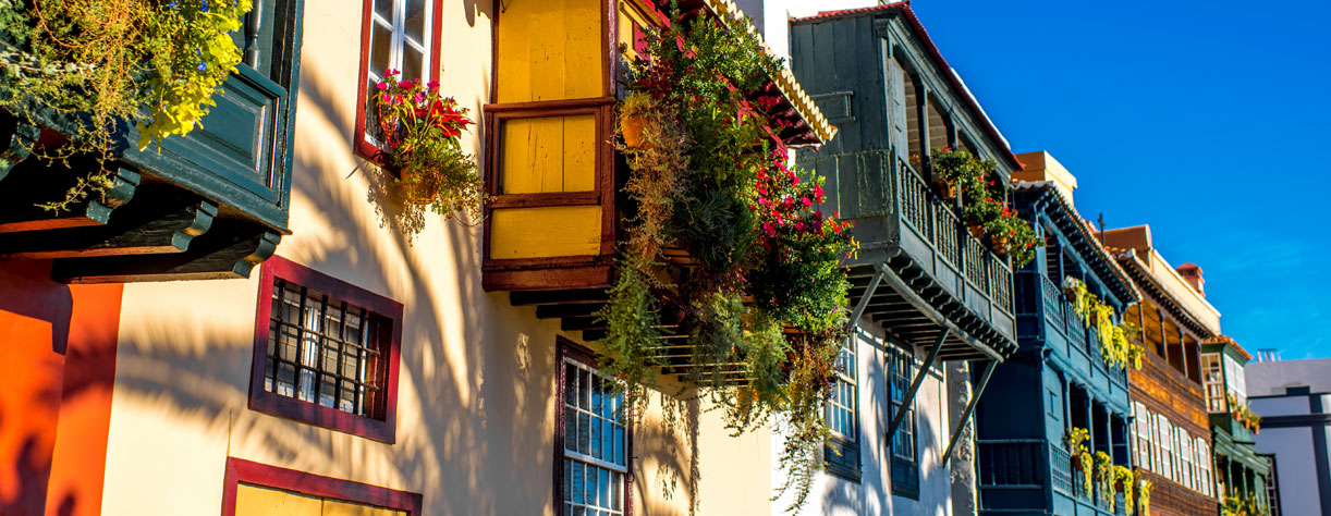 Traditional building with balcony flowers, Spain