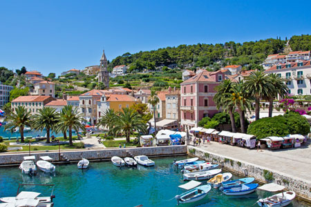Hvar city scape with boats and mountain range, Croatia
