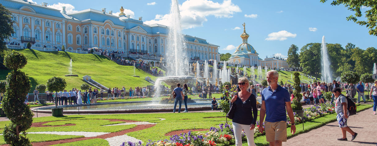 Couple walking around Peterhof in St. Petersburg, Russia