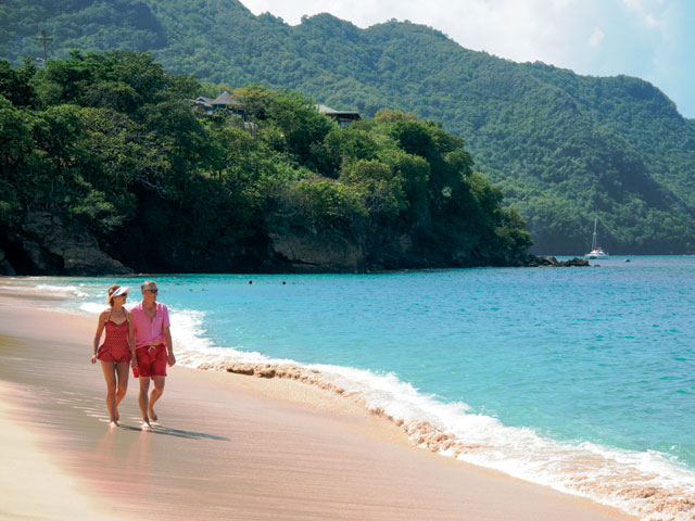 Couple walking along the Caribbean beach