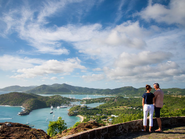 Couple at Shirley Heights looking out over Nelson's Dockyard and English Harbour Antigua