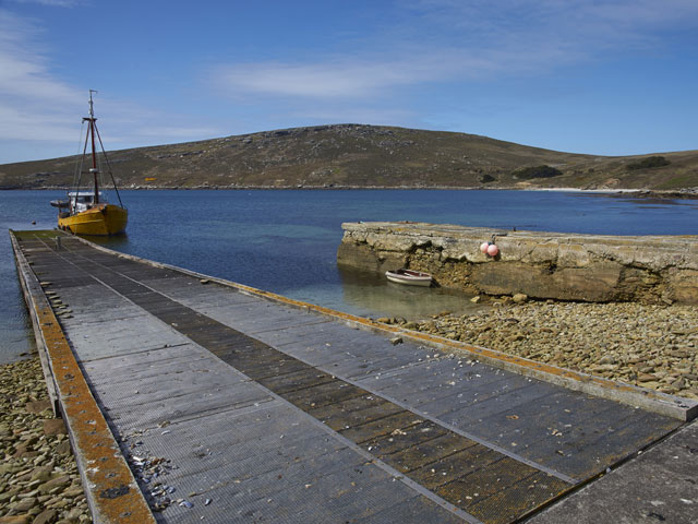 Converted trawler tied up on the jetty at the West Point Settlement on West Point Island in the Falkland Islands