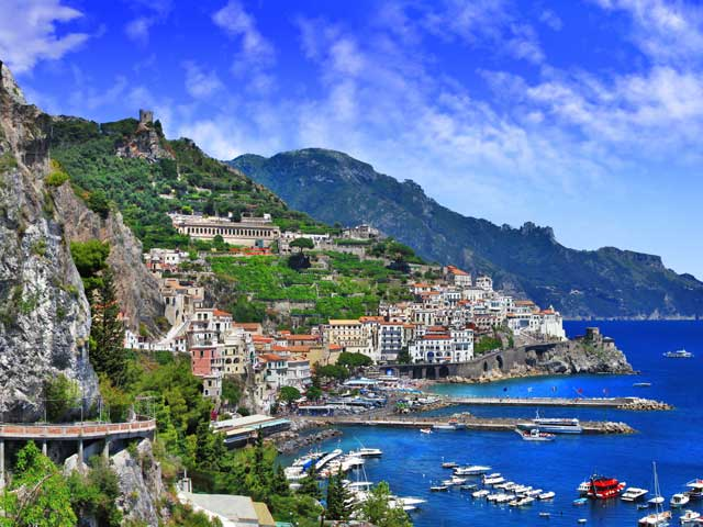 Italy scenic Amalfi coast view with cave and serpantine road