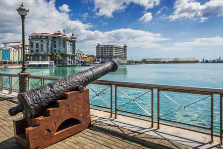 Old cannon on the promenade at Caudan Waterfront Port Louis