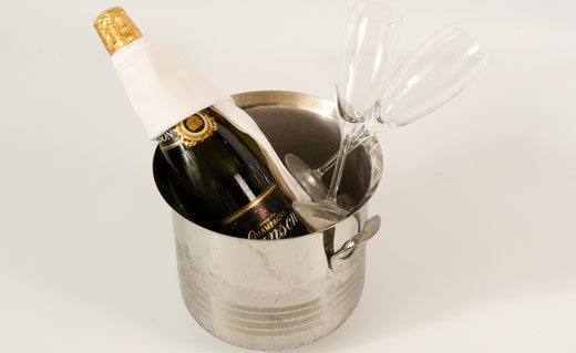 Champagne in ice bucket with glasses