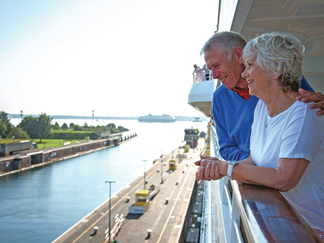 Couple looking over the side of the ship onto the Kiel Canal