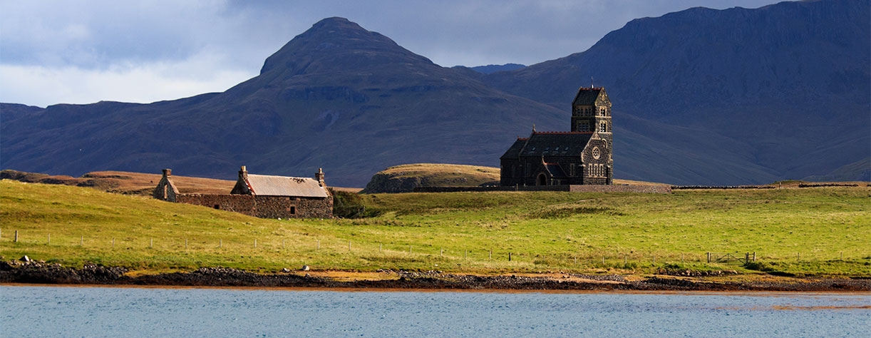 the old church on the isle of Canna in the Hebrides in Scotland with dramatic clouds