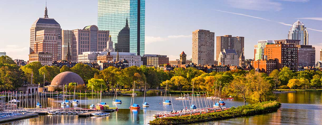 Boston, Massachusetts, USA city skyline on the river.