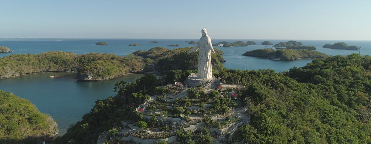 Statue of Jesus Christ on Pilgrimage island in Hundred Islands National Park, Phillippines
