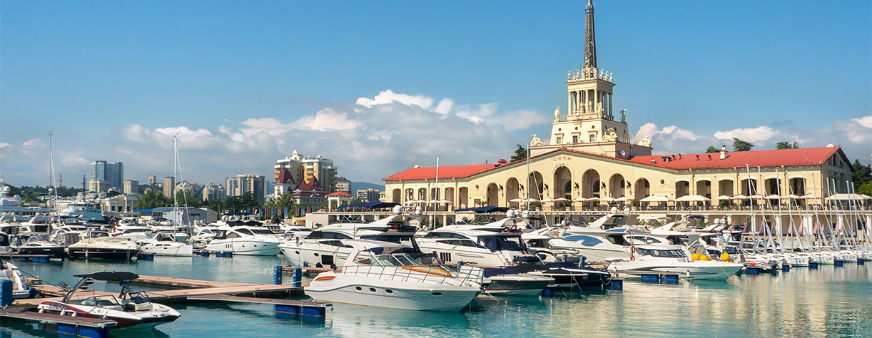 Commercial seaport of Sochi, Russia. Yachts and ships on Black Sea.
