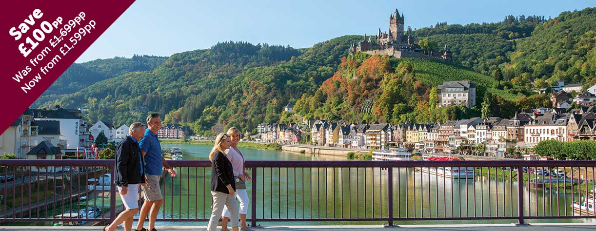 Friends walking across bridge in Cochem, Reichsburg Castle