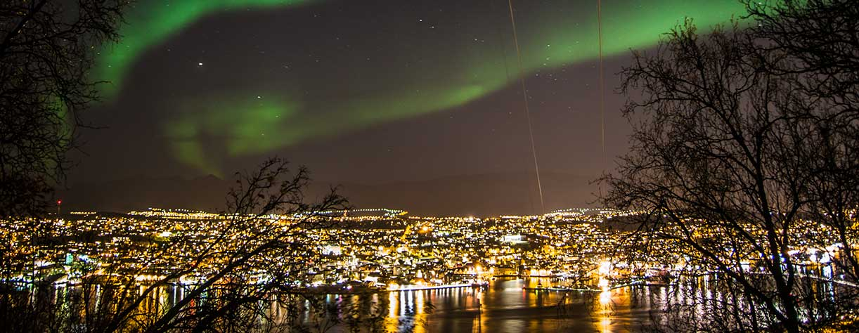 Spectacular Northern Lights over Tromso at night
