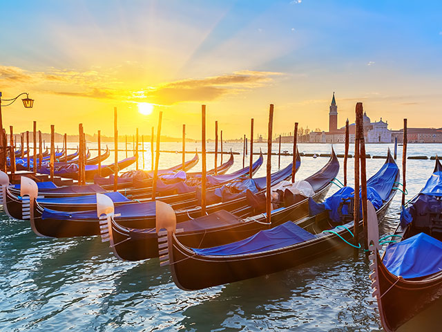 Venice gondalas with stunning sunset