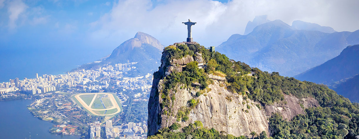 Statue of Christ the Redeemer overlooking Sugar loaf mountain in Rio, Brazil