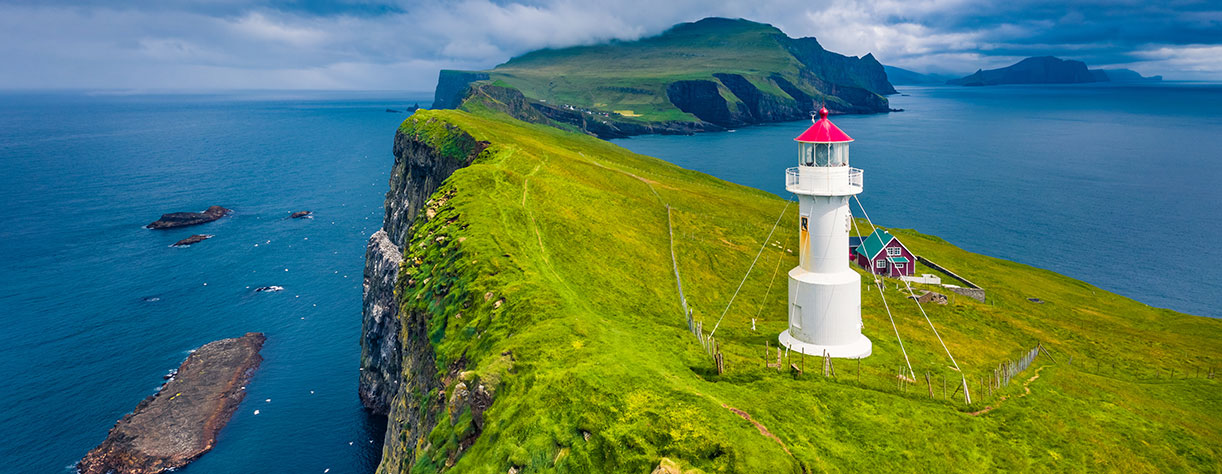 View of Mikines islands with old lighthouse, Faroe Islands