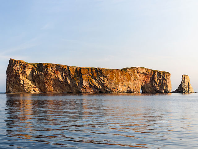 Perce Rock view with reflections at Gaspe Peninsula coast in Quebec, Canada.