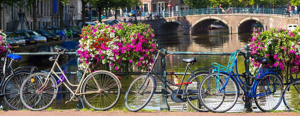 Bicycles over the bridge, canal, Amsterdam