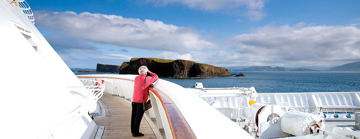 Lady looking out to Fingal's cave from on board